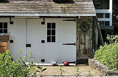 a garden shed converted from a garage
