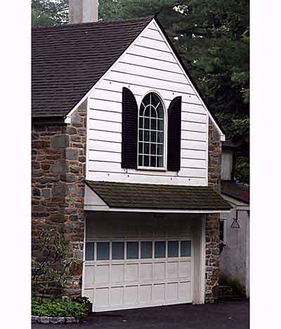 garage door with a palladian window above it