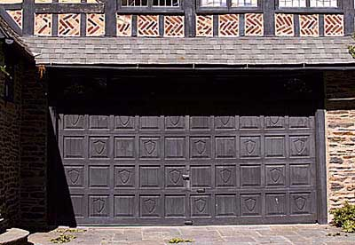garage door with a tudor style facade