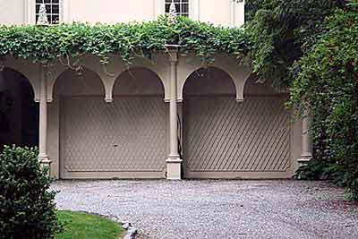 garage doors with wisteria growing on top of it