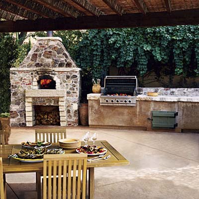 Pizza Oven with gas grill and pergola in outdoor kitchen