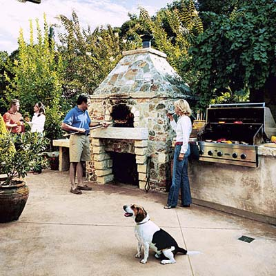 Pizza oven with custom hearth in outdoor kitchen