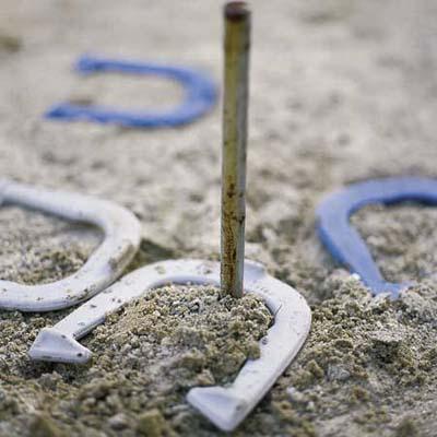 horseshoes around a peg