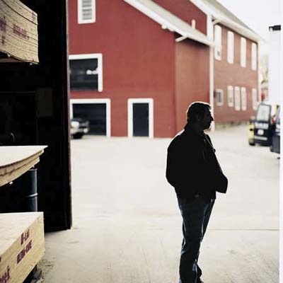 Norm Abram pauses to look around at lumberyard