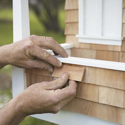 attaching shingles to a craftsman doghouse