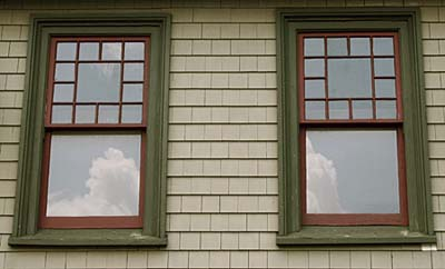 Window partnering a multi-pane top sash