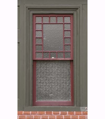 window with vintage patterned glass
