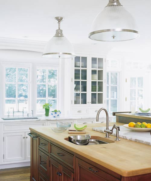 kitchen remodel after with white cabinets, marble countertop, kitchen island