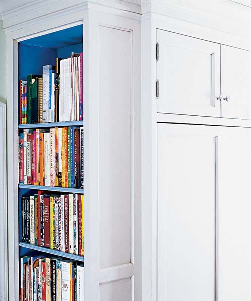 kitchen after remodel with built-in bookshelf to hold cookbooks