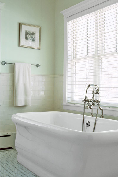 vintage-look tub with edwardian style tub filler
