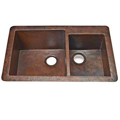 handmade copper sink offers a rugged texture at a price
