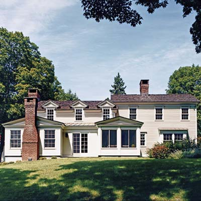 six-over-six dormers and cedar clapboards and shingles on rehabbed 1834 farmhouse exterior