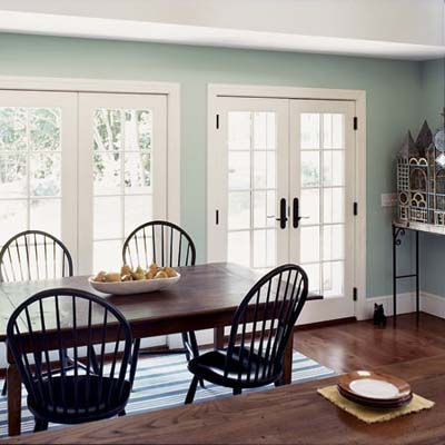 French doors and dining room table in rehabbed 1834 farmhouse