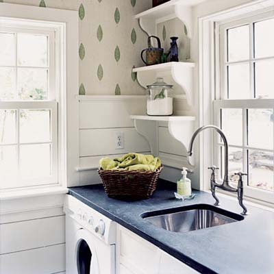 1920s-style laundry room with shelves with brackets, soapstone counter, wainscoting