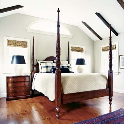 master bedroom with decorative rafters