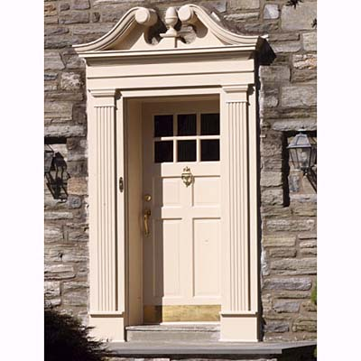 entryway with swan's neck & fluted pilasters