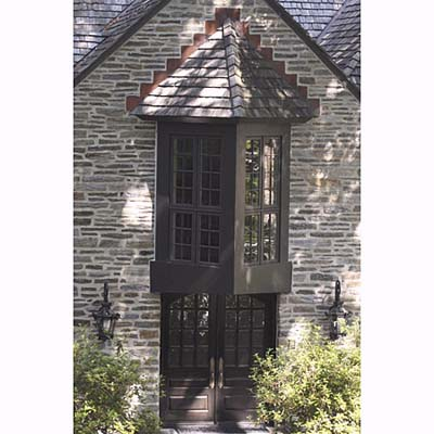 two-sided bay window & steeply arched gable entryway
