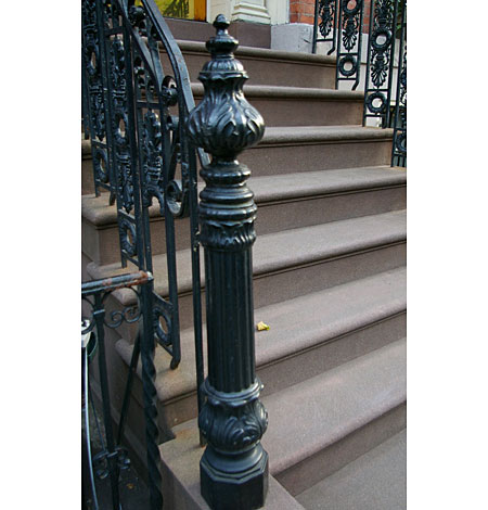 Stairs doused in ornamental cast-iron detail.