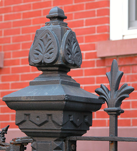 Architectural iron with motif.