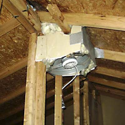 exhaust fan attached to roof with a mish-mash of material