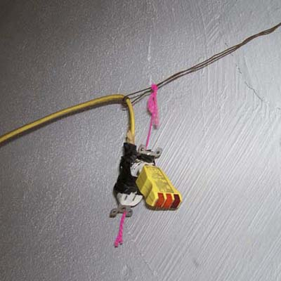 receptacle hanging by thread