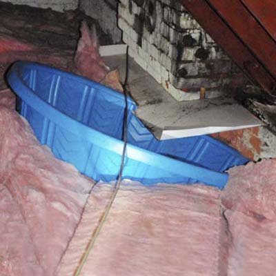 kiddie pool in attic collecting the water from a leaky roof