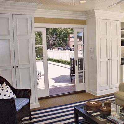 divided-light pocket doors that lead to a pool and patio