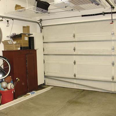 before photo of the garage that was converted into a rec room