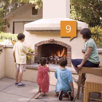 outdoor kitchen fireplace with children roasting marshmallows