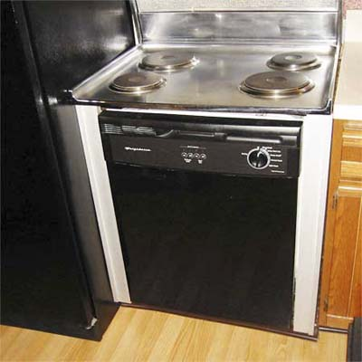 electric cook-top installed on a dishwasher next to a refrigerator