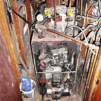 a derelict furnace in such bad condition the owner kicks it to make it work at all