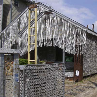 a house in texas covered in beer cans
