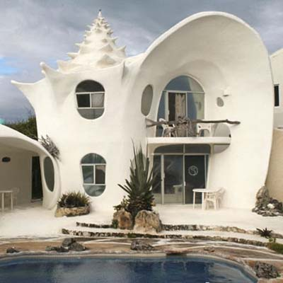 concrete shell-shaped house in mexico