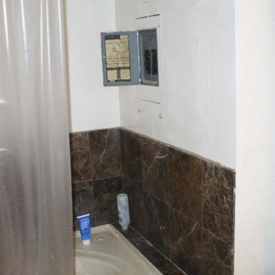 an electrical panel located within a shower area