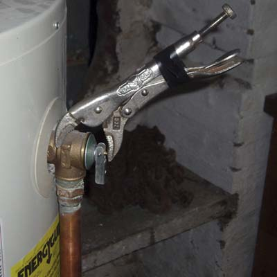a TPR valve tightened with a pair of locking pliers that are held in place with electrical tape
