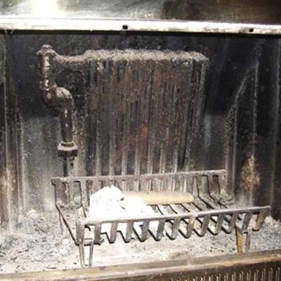 a boiler radiator found in a fireplace