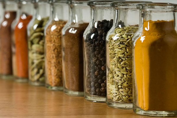 spices in glass jars in a row