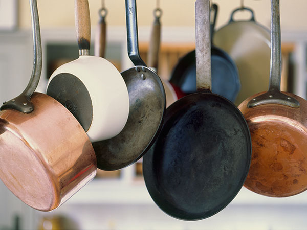 hanging pans in a row