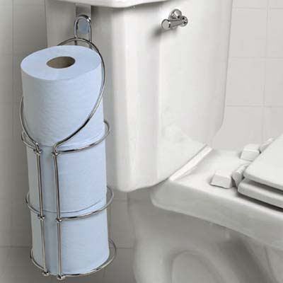 cleaver rack for spare toilet paper hanging on the side of a toilet tank in a guest bath