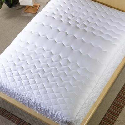 looking down on a mattress with pad exposed