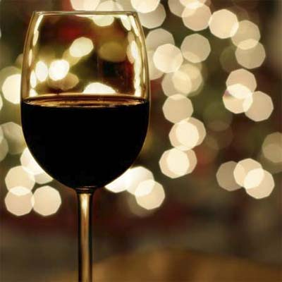 close up of a full glass of wine in a holiday setting