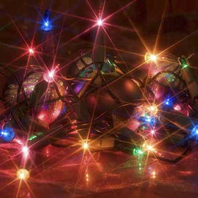 lit string of christmas lights in bright colors