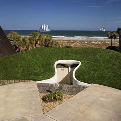 a house built into the side of a dune in Atlantic Beach, FL