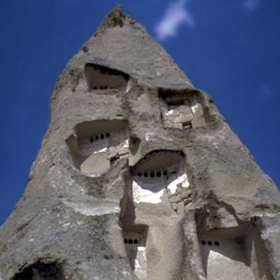 a house carved from rock created by volcanic eruptions in Cappadocia, Turkey