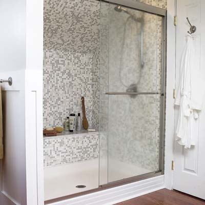 shower with mosaic tile in a remodeled attic