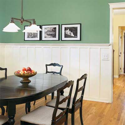 board and batten wainscoting in teal colored dining room