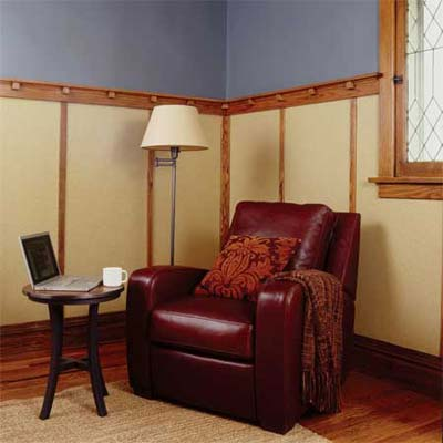 den featuring wainscoting with large flat panels