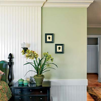 low and high wainscoting share a wall in this dramatic bedroom