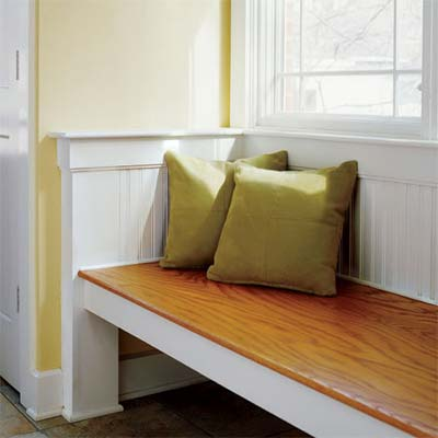 beadboard wainscoting used as the back and sides of a window seat