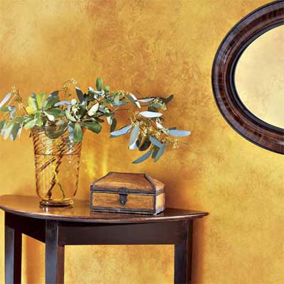 example of shimmer painting technique with gold flecked glaze over copper colored wall
